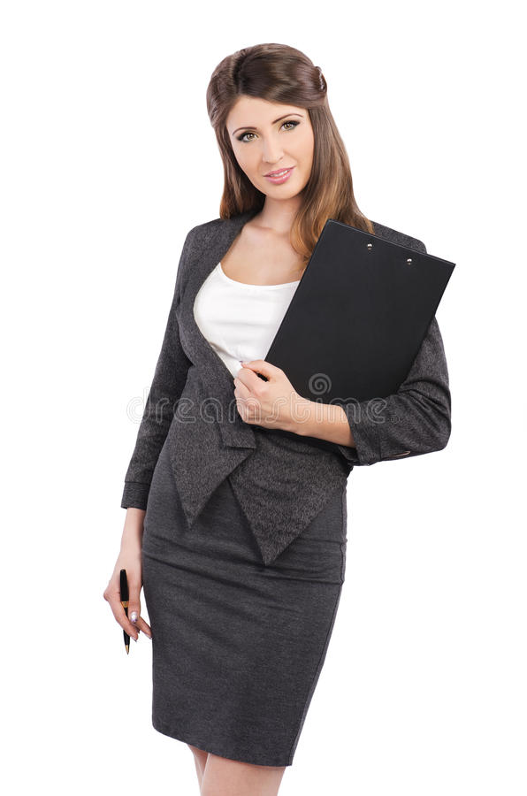 Businesswoman. In business suit holding pen and folder royalty free stock photo