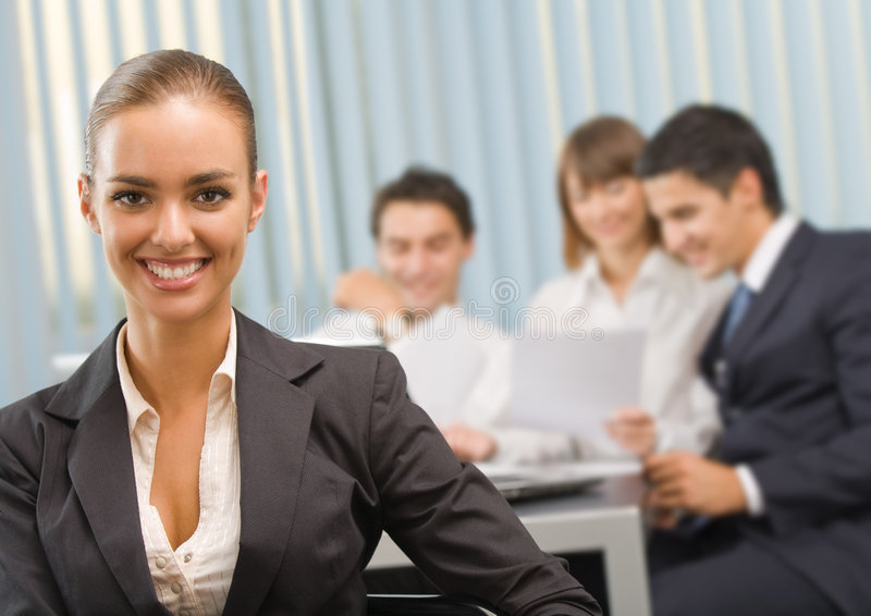 Businesswoman and business team. At office meeting stock photo