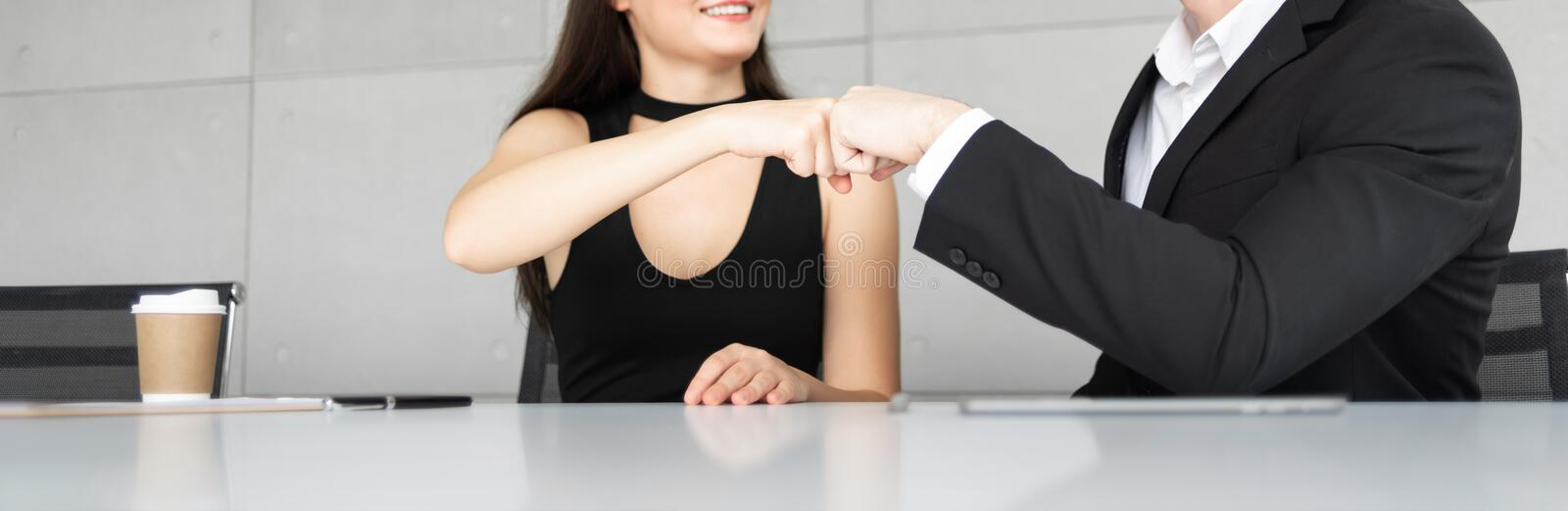 Businesswoman and Businessman in black suits are making fits stock photography