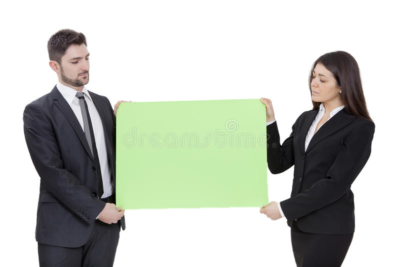 Businesswoman and businessman keeping signboard stock image