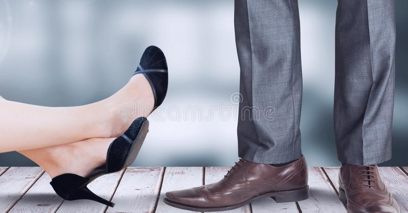 Businesswoman and businessman`s feet and shoes. Digital composite of Businesswoman and businessman`s feet and shoes stock photo