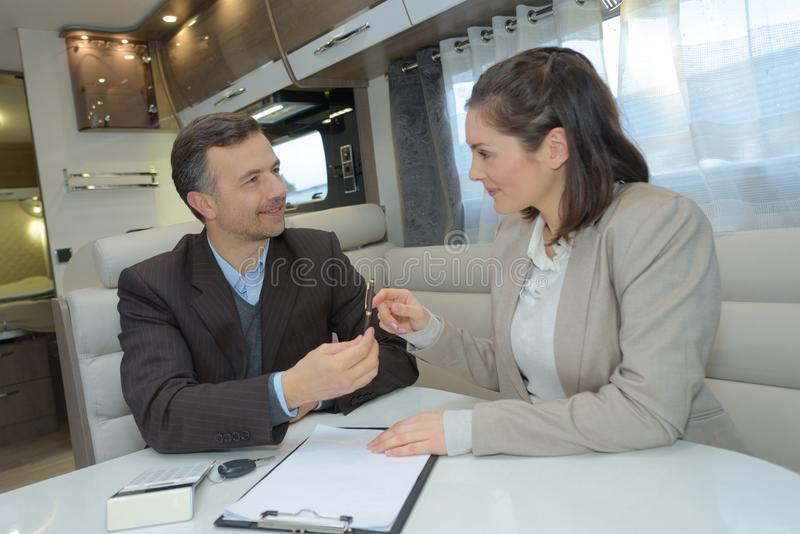 Businesswoman and businessman signing contract royalty free stock image