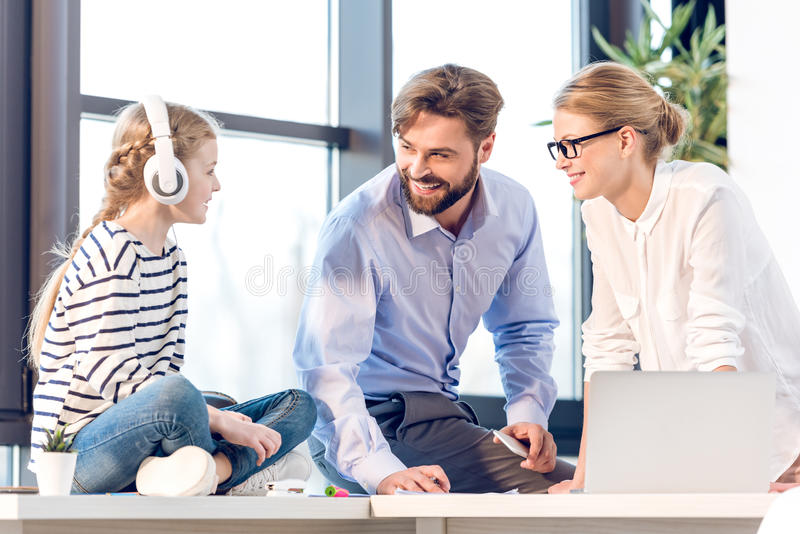 Businesswoman and businessman working with laptop royalty free stock image
