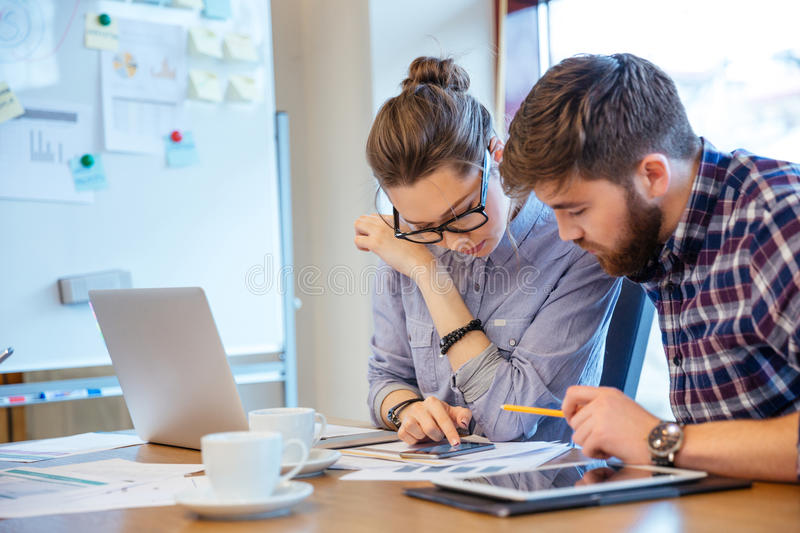 Businesswoman and businessman working in office royalty free stock photo