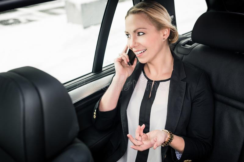 Businesswoman on call in car royalty free stock photography