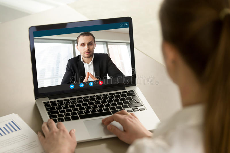 Businesswoman calling businessman online by video chat pc app, c. Businesswoman calling businessman online by video chat computer app, partners negotiating stock images