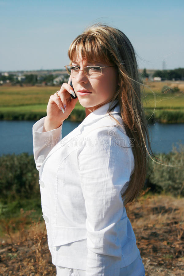 Businesswoman Calling By Mobile Phone Stock Image