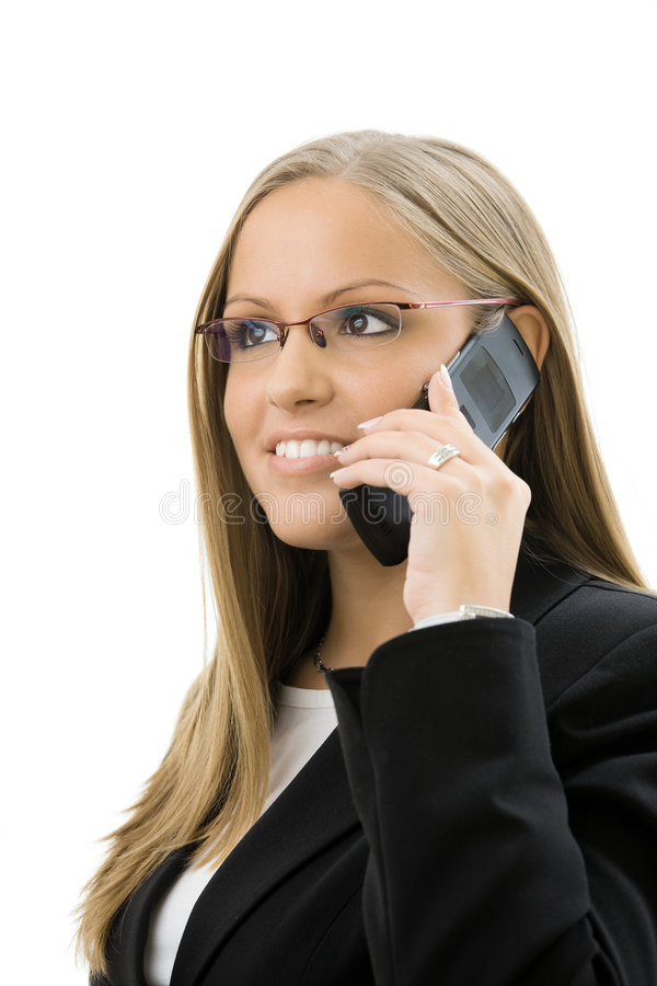 Businesswoman calling on mobile phone royalty free stock image