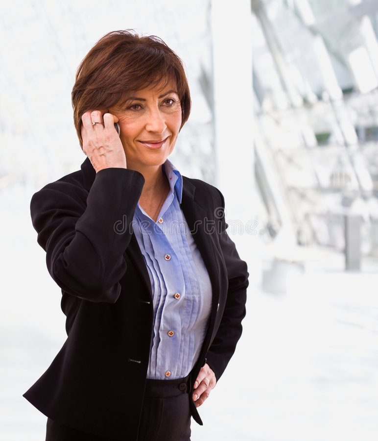 Businesswoman calling on phone royalty free stock photos