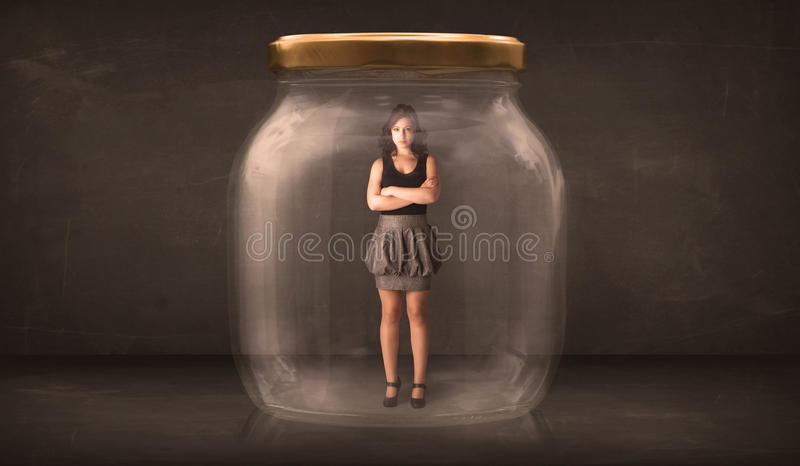 Businesswoman captured in a glass jar concept stock images
