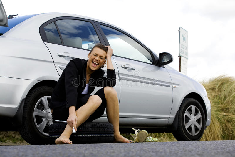 Businesswoman in a car failure royalty free stock photography