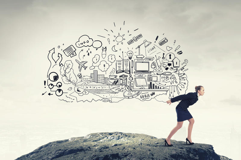 Businesswoman carrying out idea. Young businesswoman carrying her great business plan on back royalty free stock photos