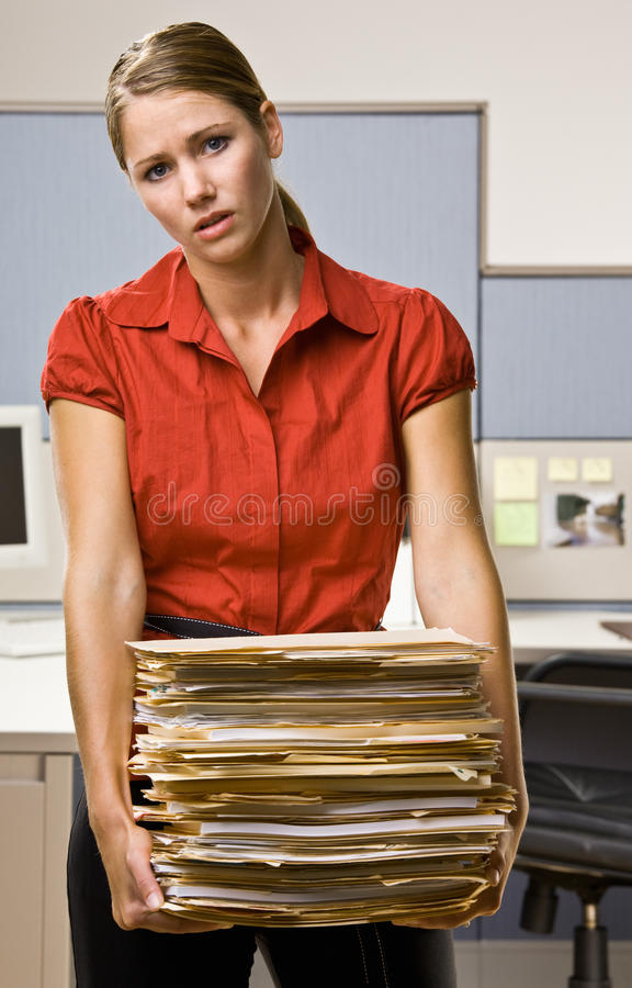 Businesswoman Carrying Stack Of File Folders Royalty Free Stock Photos