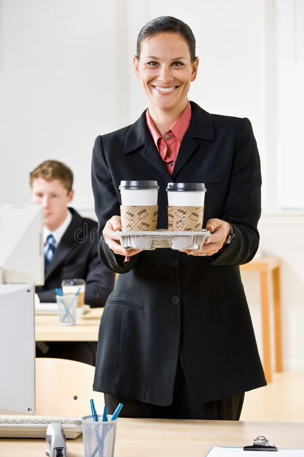 Download Businesswoman Carrying Tray Of Coffee Stock Image - Image: 17057245