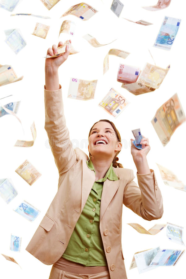 Businesswoman catching Euro. Happy businesswoman standing in a rain of Euro banknotes royalty free stock photos