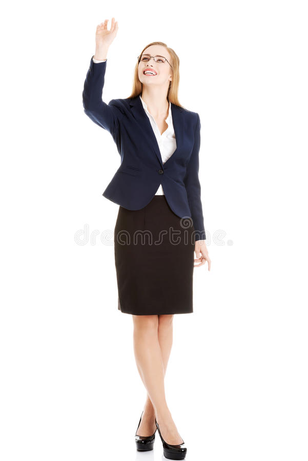Businesswoman catching something stock image