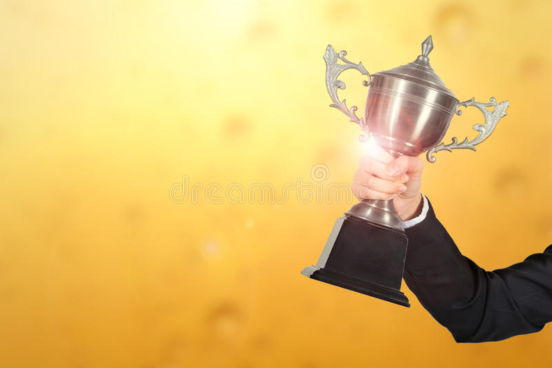 Businesswoman celebrating with holding trophy award for success royalty free stock photography