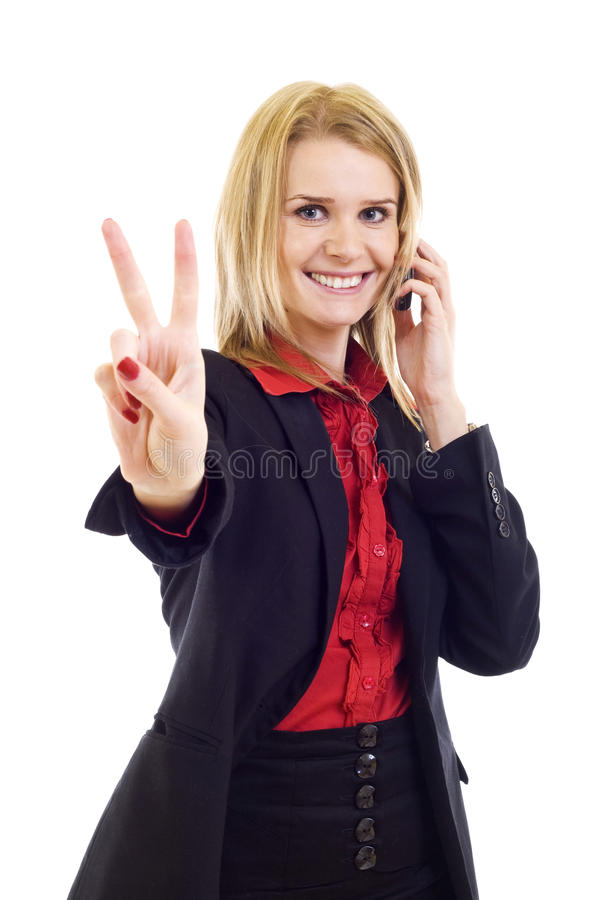 Businesswoman on the cell phone celebrating royalty free stock photography