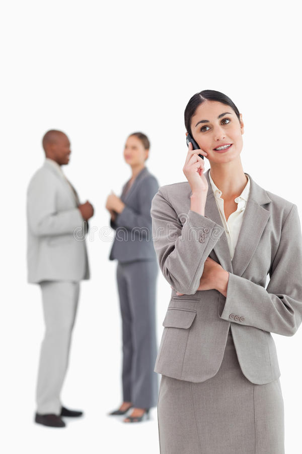 Download Businesswoman With Cellphone And Colleagues Behind Her Stock Photo - Image: 22859892