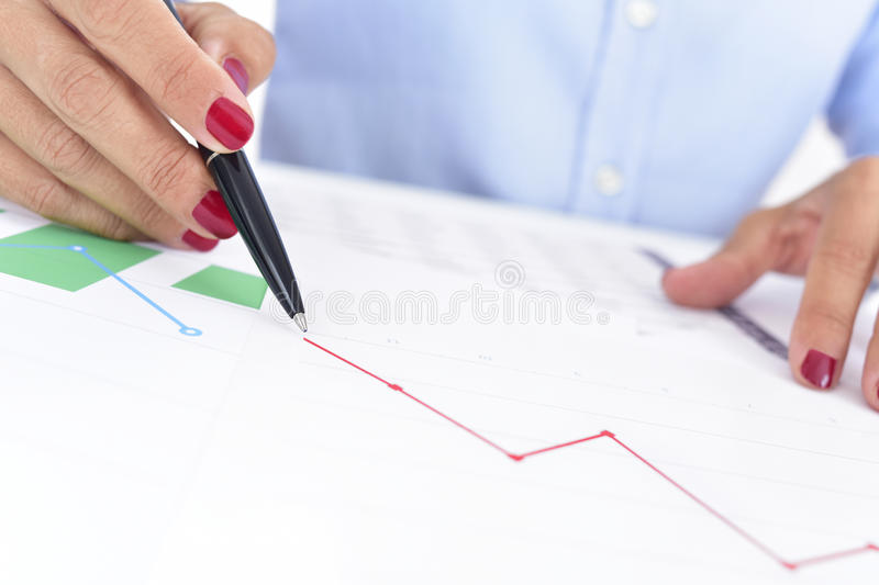 Businesswoman with a chart with a downward trend royalty free stock photos