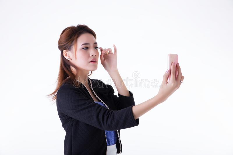 Businesswoman checking her makeup stock images