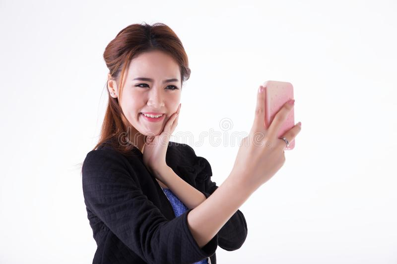 Businesswoman checking her makeup royalty free stock photos