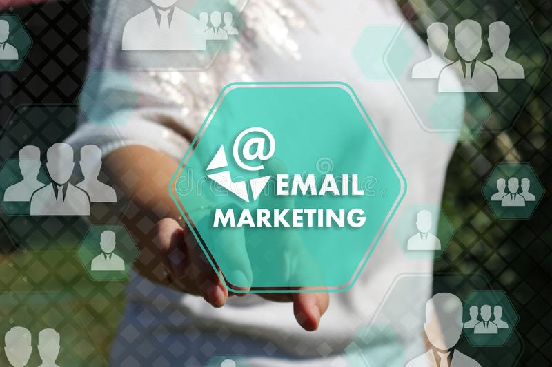 Businesswoman chooses EMAIL MARKETING on the touch screen with a futuristic background .Trend colors. Businesswoman chooses EMAIL MARKETING on the touch screen stock photography