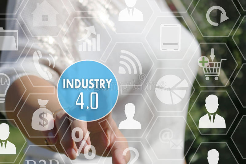 The businesswoman clicked the button industry 4.0. On the touch screen royalty free stock photos