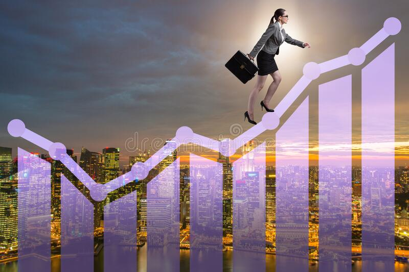 Businesswoman climbing bar charts in growth concept royalty free stock images