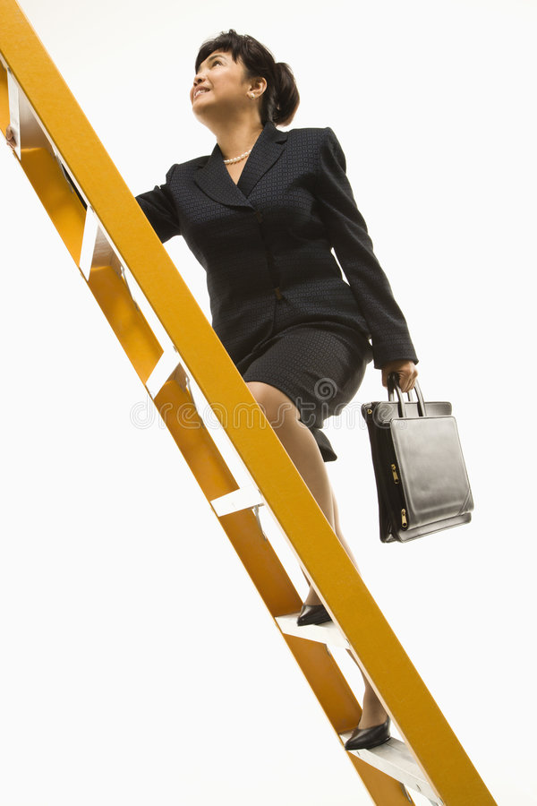 Businesswoman Climbing Ladder. Royalty Free Stock Image