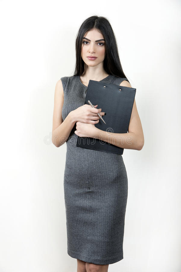 Businesswoman with clipboard stock photos