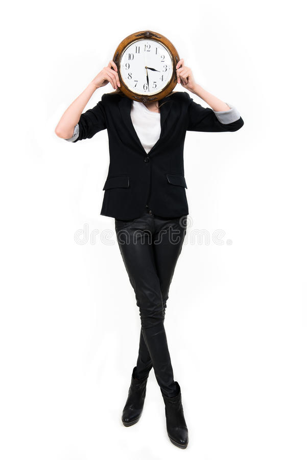 Businesswoman with clock ful height - time concept stock images