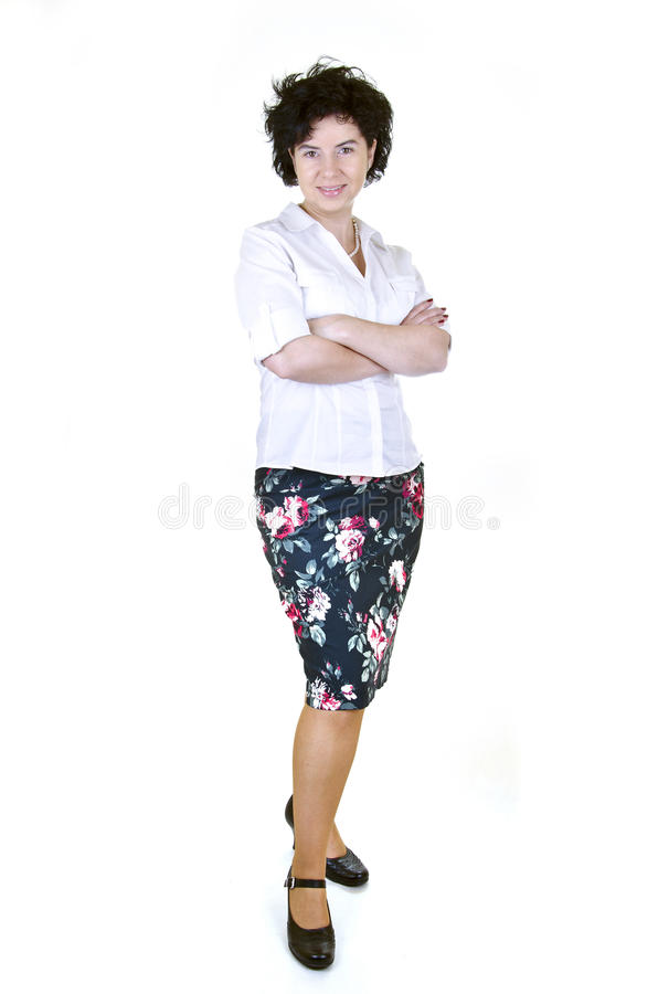 Businesswoman in colorful skirt. Smiling businesswoman in a white blouse and colorful skirt royalty free stock photography
