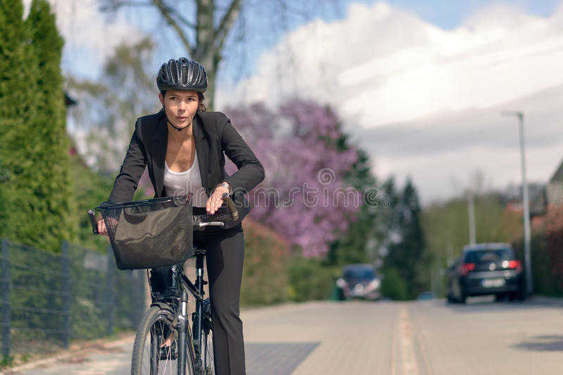 Businesswoman Commuting on a Cycle Going to Office royalty free stock image