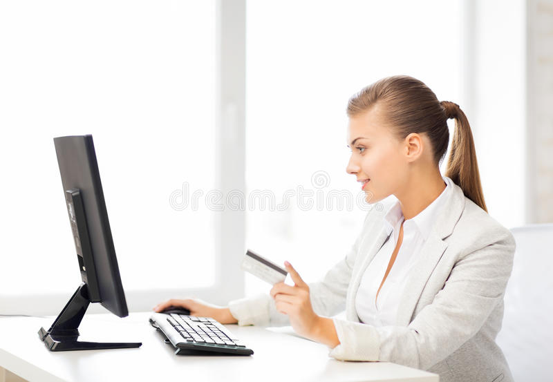 Businesswoman with computer using credit card stock photos