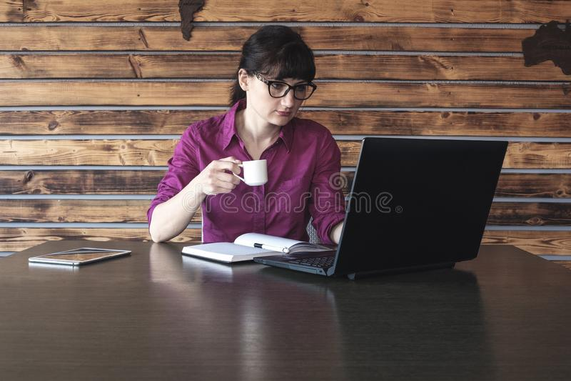 Businesswoman concentrating on her work royalty free stock photography
