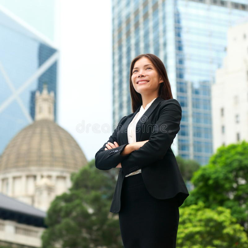 Businesswoman confident outdoor in Hong Kong. Businesswoman confident outside. Business woman standing proud and successful in suit cross-armed. Young royalty free stock photography