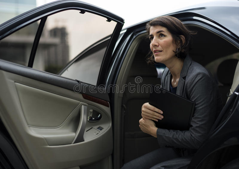 Businesswoman Corporate Taxi Transport Service Concept. Businesswoman Corporate Taxi Transport Service royalty free stock image