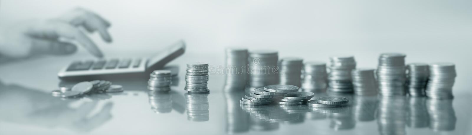 Businesswoman counts on a calculator background of coins. Business concept 5.0 royalty free stock photos
