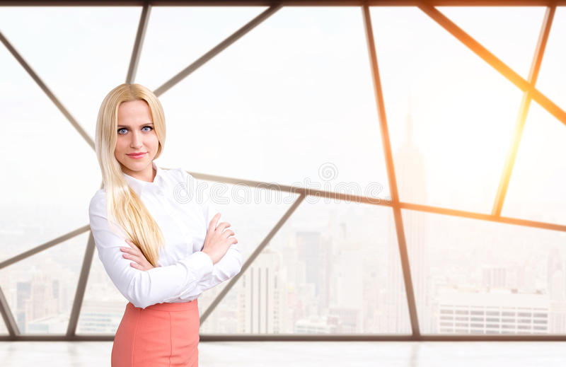 Businesswoman with crossed hands stock photography