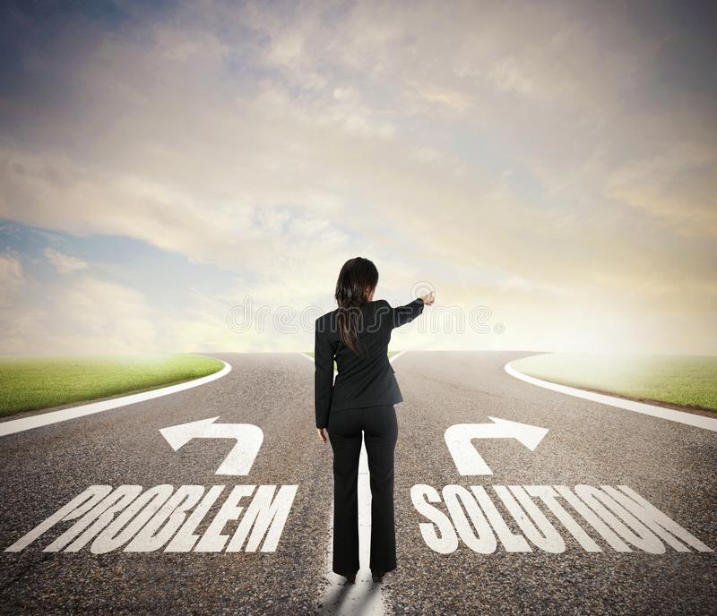 Businesswoman at a crossroads. She chooses the correct way. Concept of decision in business. Life stock images
