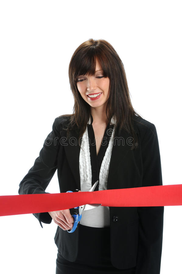 Businesswoman Cutting Red Ribbon. Isolated over white background royalty free stock image