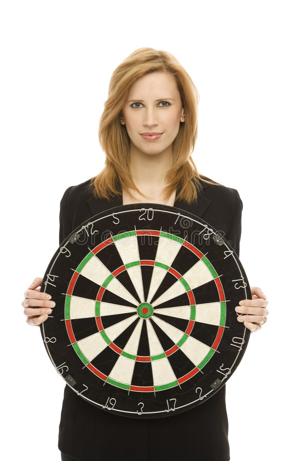 Businesswoman with dart board stock photography
