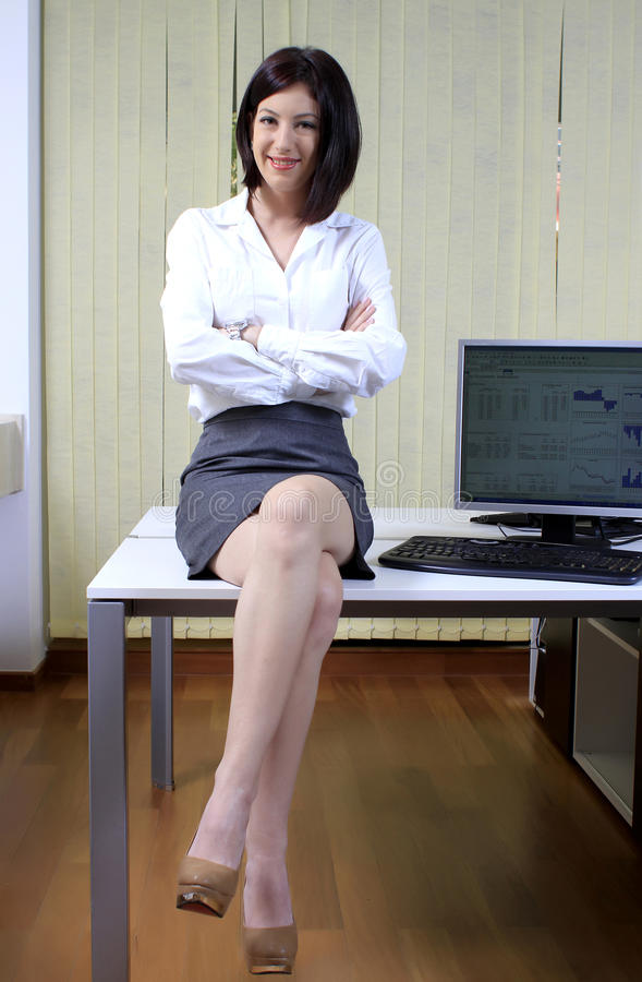 Businesswoman on the desk stock images