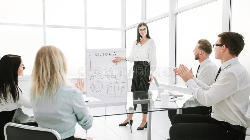 Businesswoman discusses with the business team a new business strategy. stock image