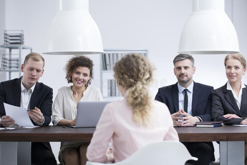 Businesswoman discussing resume with recruiters stock photography