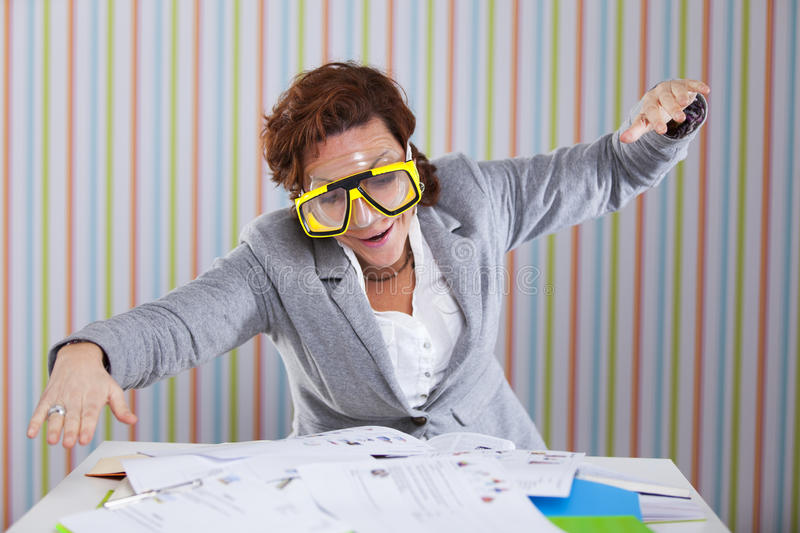 Businesswoman diving in her work royalty free stock image
