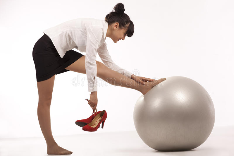 Businesswoman doing exercise stock photography