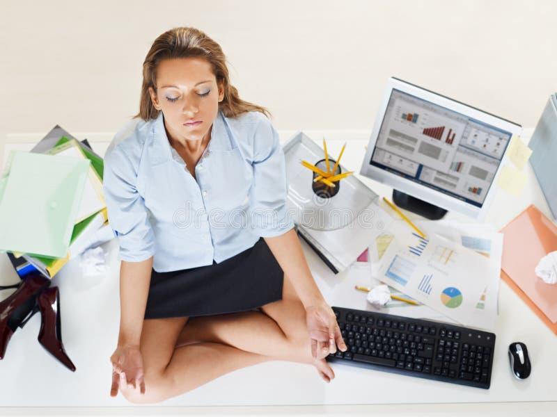 Businesswoman doing yoga stock photos