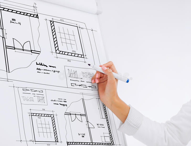 Businesswoman drawing blueprint on flip board royalty free stock photos